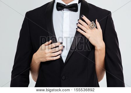 Girl hugging guy. Photo of suit with woman hands