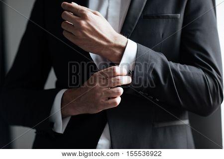 Cropped model in suit. bisnessman