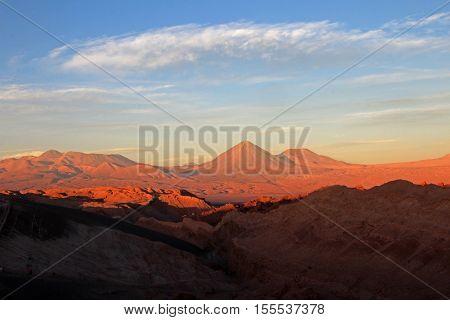 Valle de la Luna, valley of the moon, Volcan Lincancabur in the background, west of San Pedro, Atacama desert of Chile