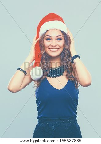 Portrait of woman in Santa hat, isolated on white background