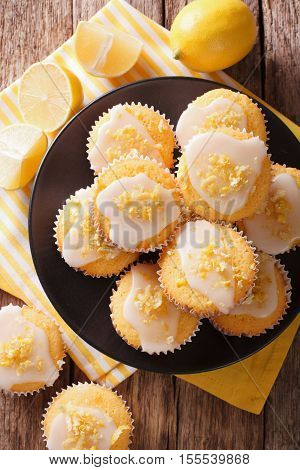 Breakfast Muffins With Lemon Zest And Icing Closeup On A Plate. Vertical Top View