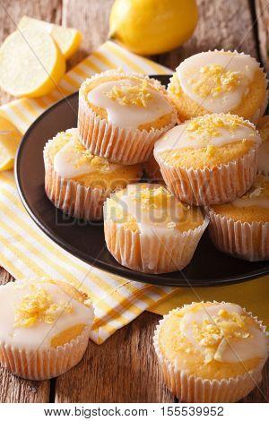 Delicious Freshly Baked Homemade Lemon Muffins Zest Sprinkles Closeup. Vertical