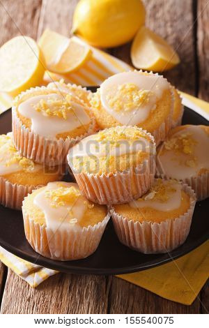 Muffins With Lemon Zest And Icing Sugar Close-up On A Plate. Vertical