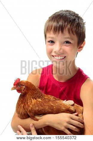 Smiling boy with his chicken on white background