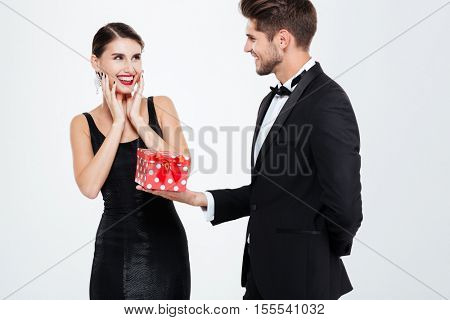 Business couple with gift. man gives a gift to his girlfriend
