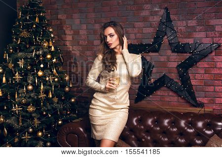 Merry Christmas To You! Dancing Girl In A Club Drinking Champagne In A Gold Dress And Smiling In Fro