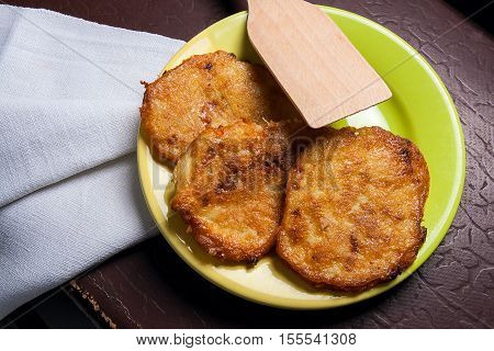 Potato Pancakes With Meat On Green Plate In Belarusian Style On Dark Background.