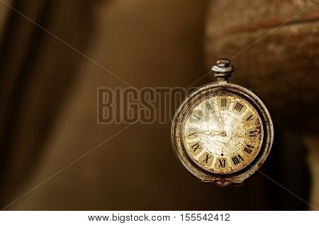 Old vintage pocket watches on a brown background