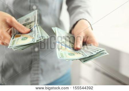 Woman counting money, closeup
