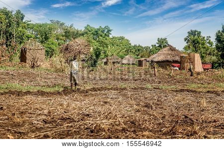 Uganda, Africa-  April 2, 2016: African woman working in the Village in Uganda Africa