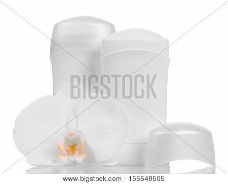 Dry deodorants for underarms and orchid flower isolated on white background.
