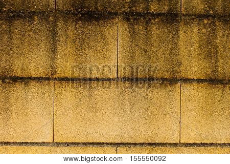 Surface of a yellow wall stained by the passage of time
