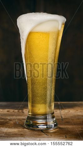 Glass Of Light Beer On A Wooden Table