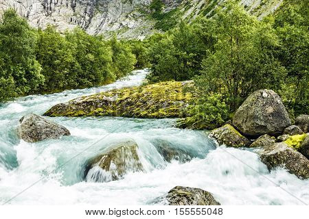 Spring water Briksdal Norway. Norwegian landscape in national park Jostedalsbreen.