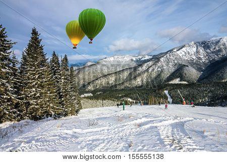 winter landscape hot air balloons resort Jasna, Tatras, Slovakia.