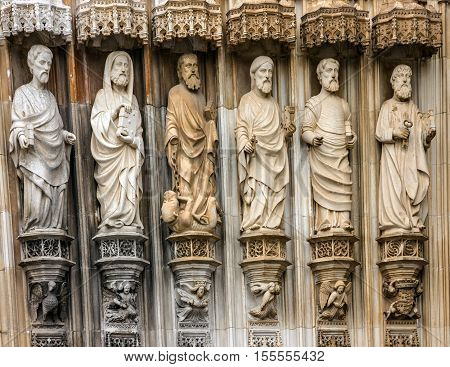 Fragment of gate with stone Apostles carving sculptural images Batalha Dominican medieval monastery, Portugal - great masterpieces of Gothic art. UNESCO World Heritage