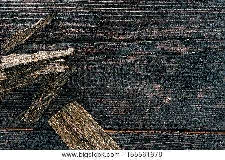 Tobacco flakes on the wooden surface. Flat lay. Selective focus