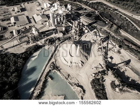 Apocalyptic Fossil Fuel Factory Open Pit Mine Limestone extraction quarry aerial drone looking down above Industrial Factory outside of Austin and Round Rock Texas
