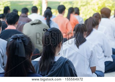 Thailand secondary education students are sitting in line for Meditation in the morning.