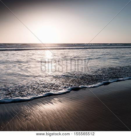 Sunset over the ocean. San Diego beach. Filter sof light