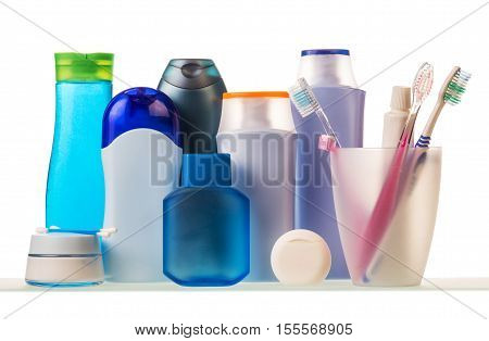 Toiletries, a glass with toothbrushes and toothpaste isolated on a white background.