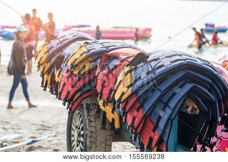 Multicolor Life Jackets, Stacked Layers On The Tuck Of The Boating Station For Rent On The Beach In
