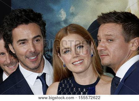 Shawn Levy, Amy Adams and Jeremy Renner at the Los Angeles premiere of 'Arrival' held at the Regency Village Theater in Westwood, USA on November 6, 2016.