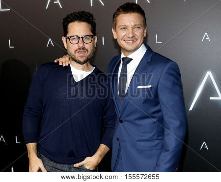 J.J. Abrams and Jeremy Renner at the Los Angeles premiere of 'Arrival' held at the Regency Village Theater in Westwood, USA on November 6, 2016.