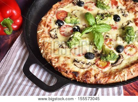 delicious vegetarian pizza, handmade pizza in a pizza pan. High angle view.