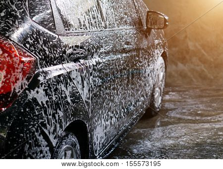 Selective Focus Of Black Car Wash With Soap
