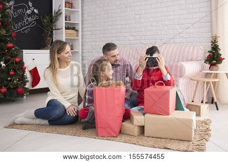 Family Unwrapping Christmas Presents