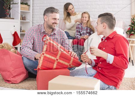 Father And Son Wrapping Gifts