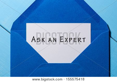 Blue Envelope with letter and note ASK AN EXPERT.