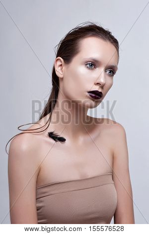 Beauty Woman with Perfect Makeup. Beautiful Professional Holiday Make-up. Purple Lips and Nails. Beauty Girl's Face .
