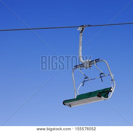Chair-lift At Ski Resort And Blue Clear Sky