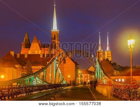 old town of Wroclaw - bridge to island Tumski at night, Poland