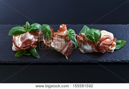 Bacon With Green Basil On A Black Background