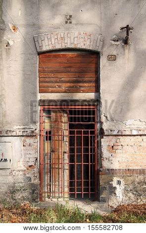 door of an old abandoned house secured with the iron bars in Frydek-Mistek, Czech Republic