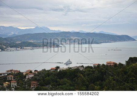 La Spezia Italy - October 11 2016: Military ship leaves the port of La Spezia in a cloudy day