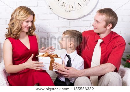 Christmas And New Year Concept - Family Exchanging Gifts
