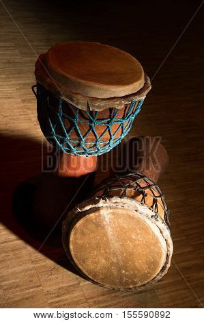 Traditional wooden african djembe drum on stage, France