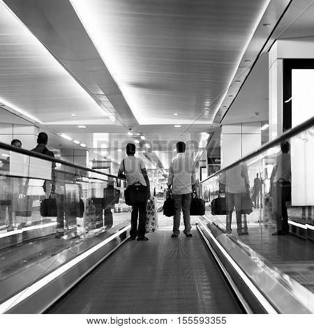 New Delhi, India - Jule 20, 2011: Passengers use travelator inside airport terminal. Indira Gandhi International Airport is the busiest airport in the India