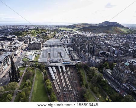 Edinburgh city historic Waverley Train Station Rail way on sunny Day Aerial shot 2