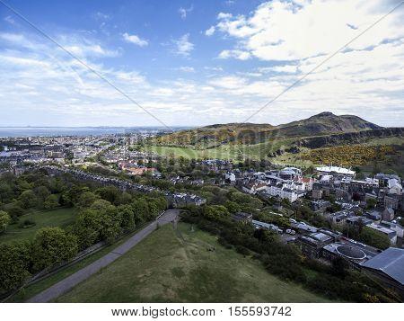 Edinburgh city the historic Arthur Seat sunny Day Aerial shot 2