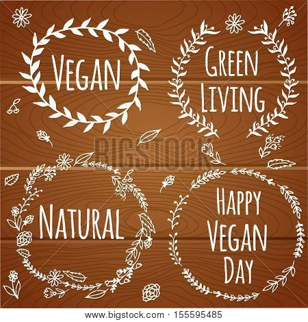 Vegan product label. World vegan day. Hand drawn rustic frame with flowers and leaves on wood background. Typography design. Vegan.