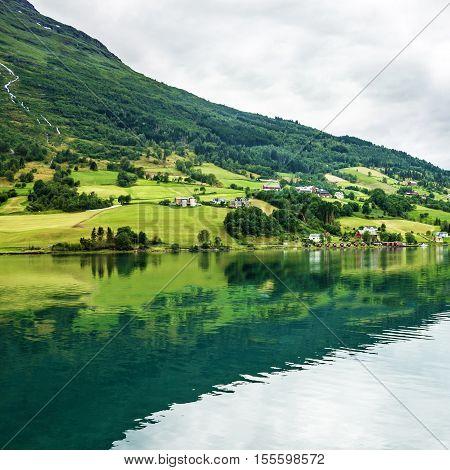 Norway, Olden, green hills seaside. fjord in summer.