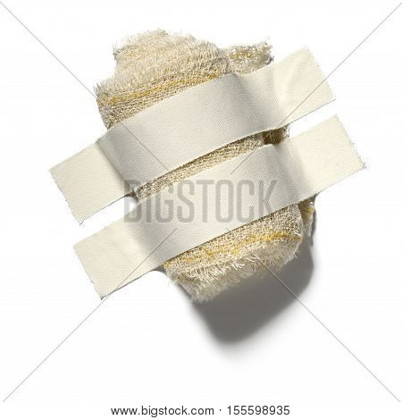 Photograph in the study of gauze roll for dressing with two strips of adhesive tape.