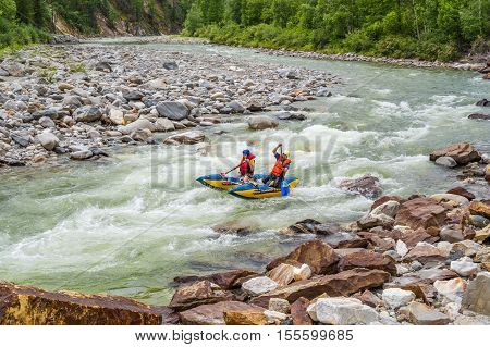 Rafting on a catamaran on the mountain river. July 3, 2016, Irkut river, Buryatia, Russia