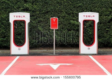 Lyon, France - October 22, 2016: Tesla supercharger station and parking in Lyon. Tesla is an American automotive and energy storage company that designs, manufactures, and sells luxury electric cars