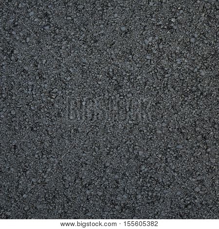 The texture of fresh asphalt lined up close. Pavement. texture of fresh asphalt. asphalt.